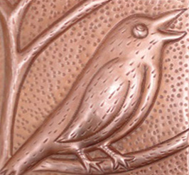 copper tile with bird design and new penny patina