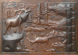 copper mural with elk and woods design