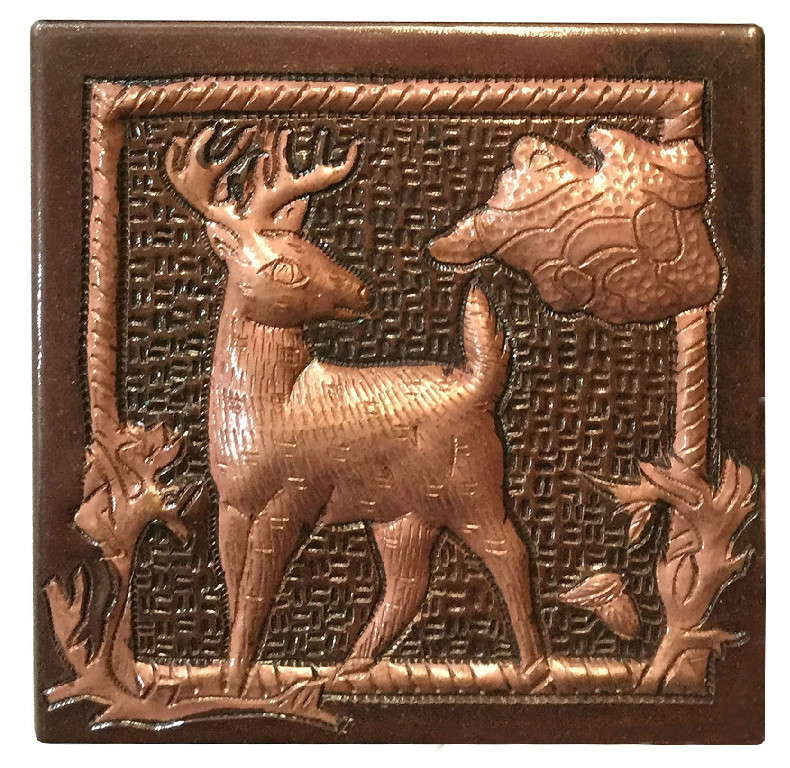 copper ile with a deer design