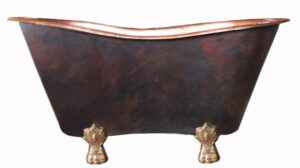 copper claw foot tub with old penny