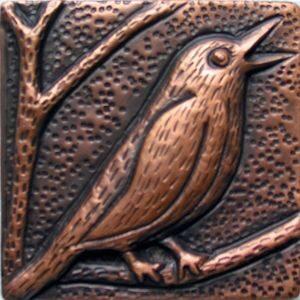 copper tile with a bird design