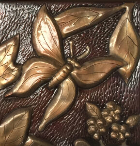 copper tile with butterfly design