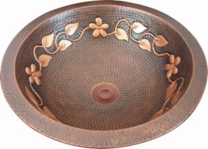 copper oval sink with leaves and flowers design