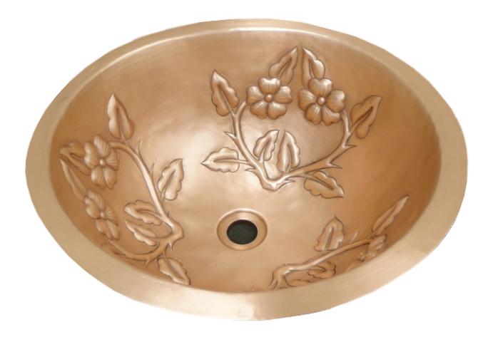 Copper sink in golden bronze with flower design