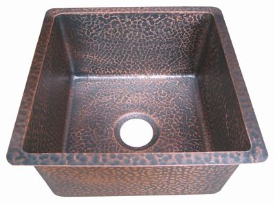 copper sink in plum patina