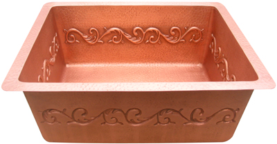 copper bar sink with decorative designs on the side