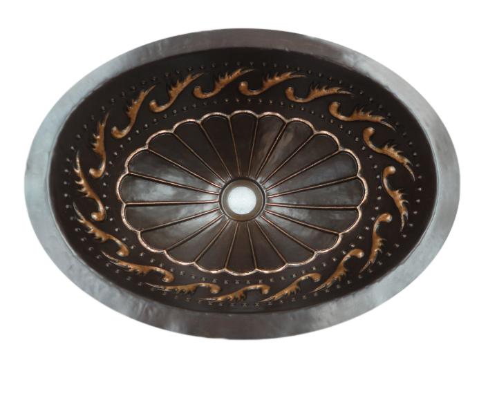 Copper sink with dark patina and golden bronze design