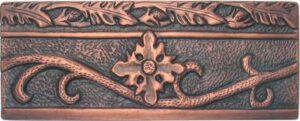 copper border tile with flower design