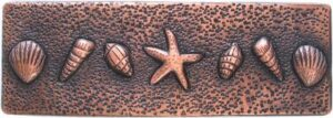 copper border tile with sea shells and star fish